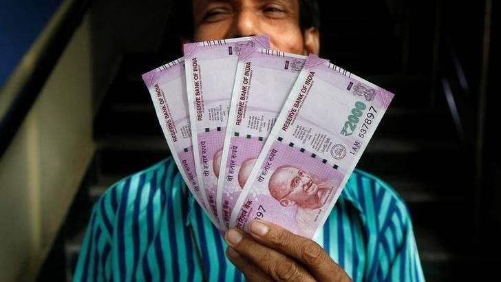 Khaleej Times - Rupee rises to 74.64 against US...