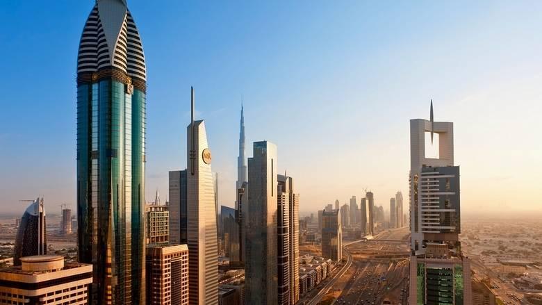 Khaleej Times - Covid-19 crisis to impact UAE,...