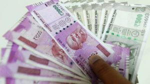 Gulf News – Indian rupee sinks to record low,...