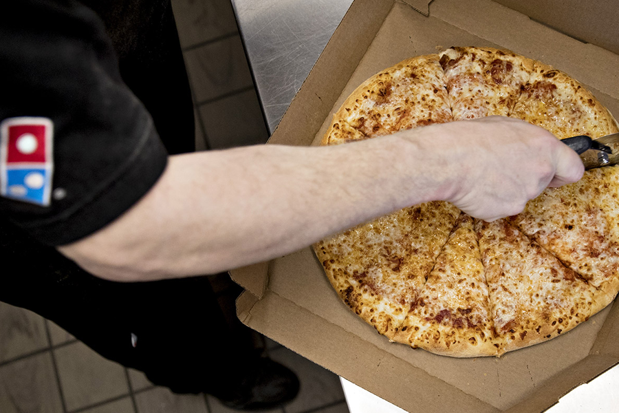 Domino's Pizza's share price has taken a bite...